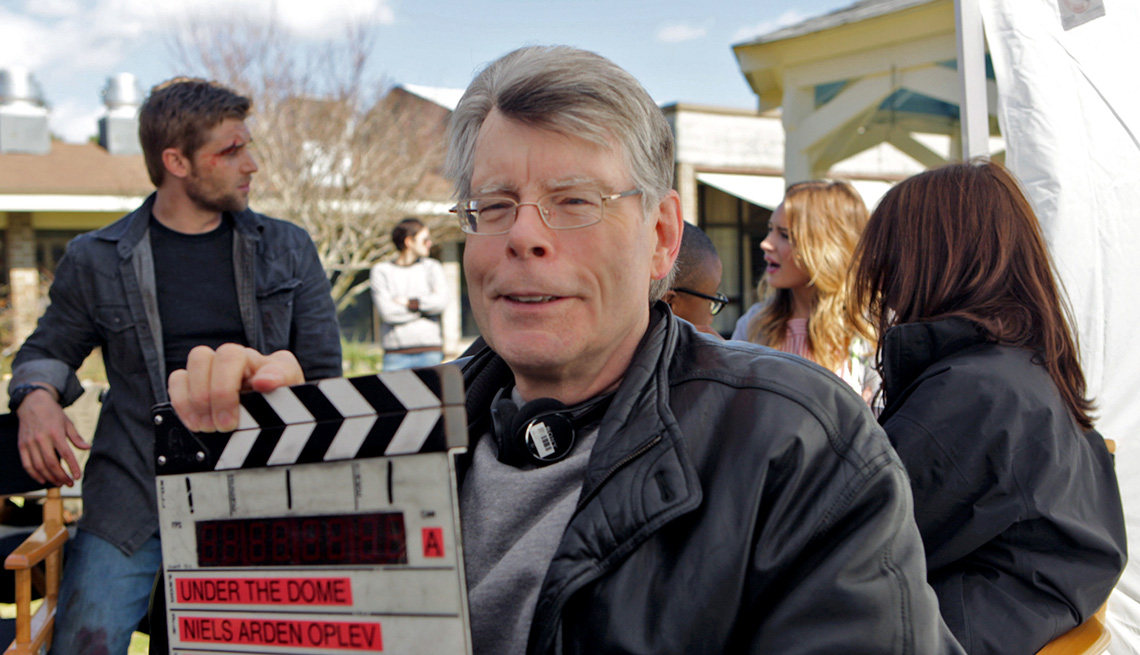 item 1 of Gallery image - Stephen King on the set of the CBS series, UNDER THE DOME, in 2011