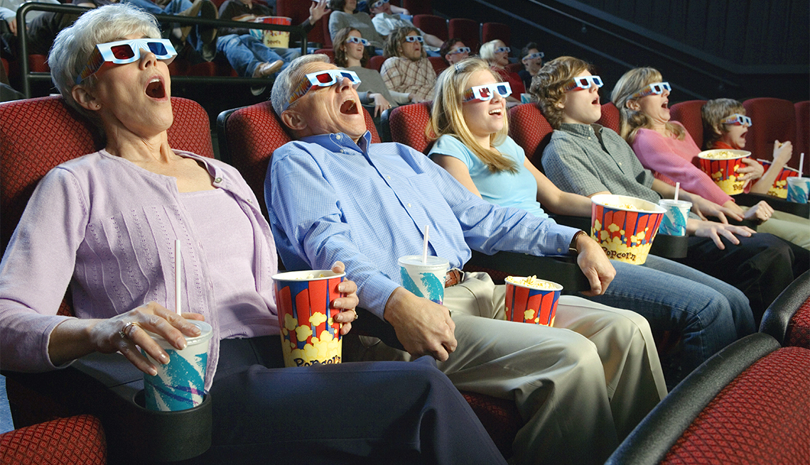Excited moviegoers watch 3D film