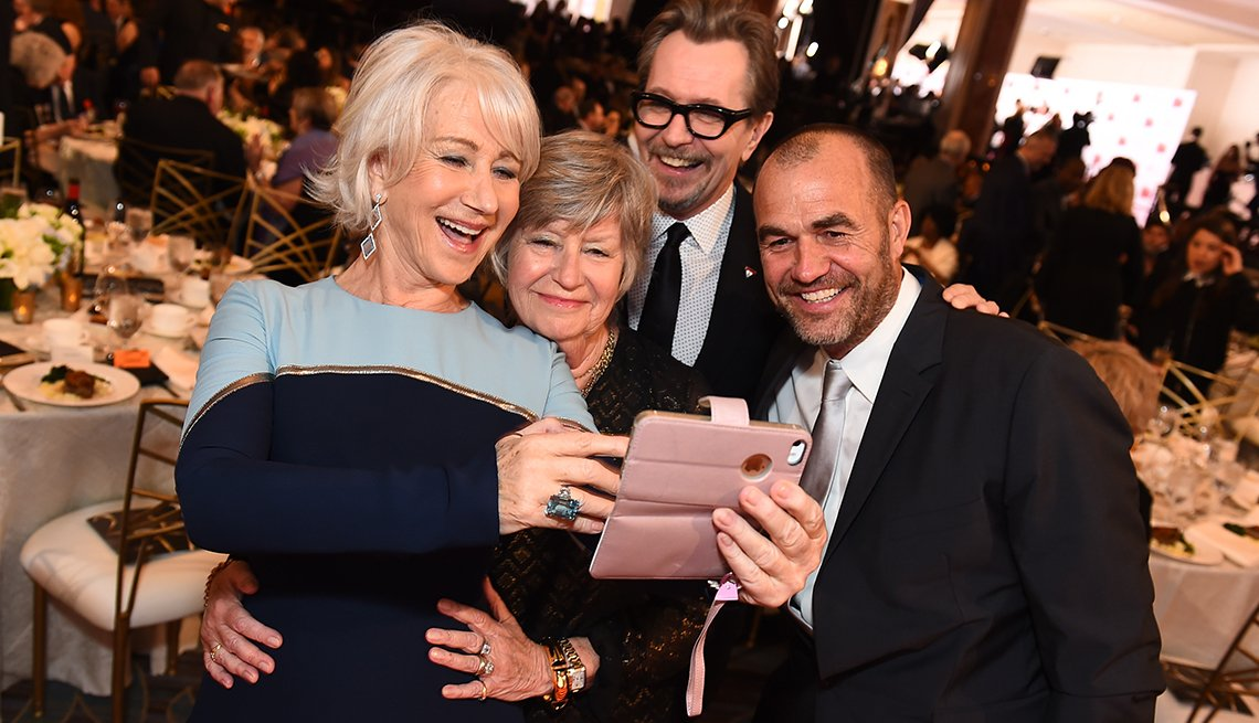 "item 16, Gallery image. Helen Mirren and others take a selfie at the 17th Annual Movies For Grownups Awards by ""AARP The Magazine."""