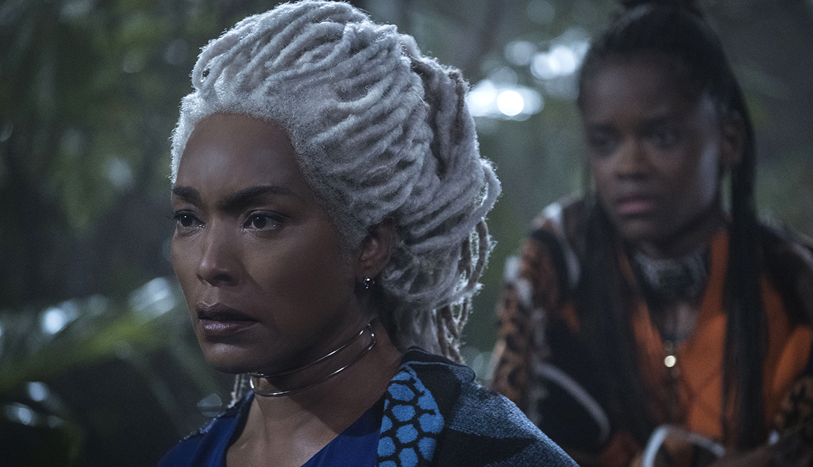 movie still from 'Black Panther', featuring Angela Bassett and Letitia Wright