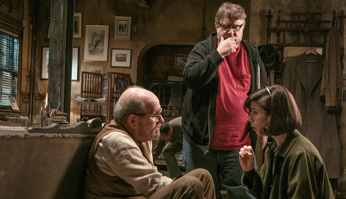 "item 5, Gallery image. Guillermo del Toro (center) directs Richard Jenkins and Sally Hawkins on the set of ""The Shape of Water"""