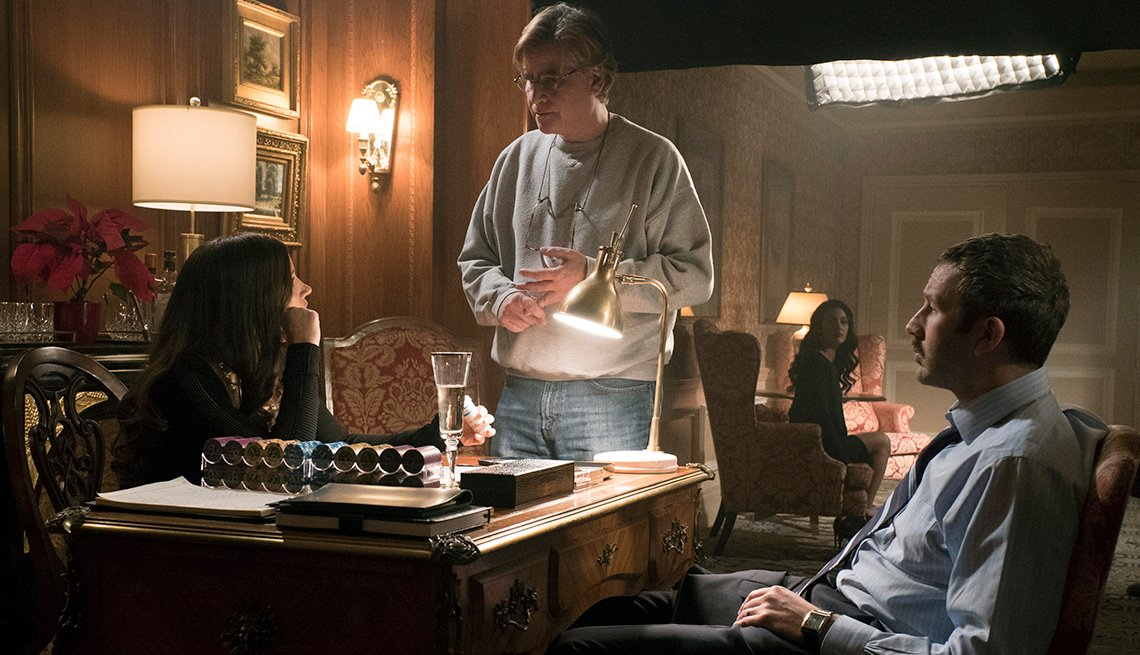 "item 9, Gallery image. Aaron Sorkin (center) directs Jessica Chastain and Chris O'Dowd on the set of ""Molly's Game"""