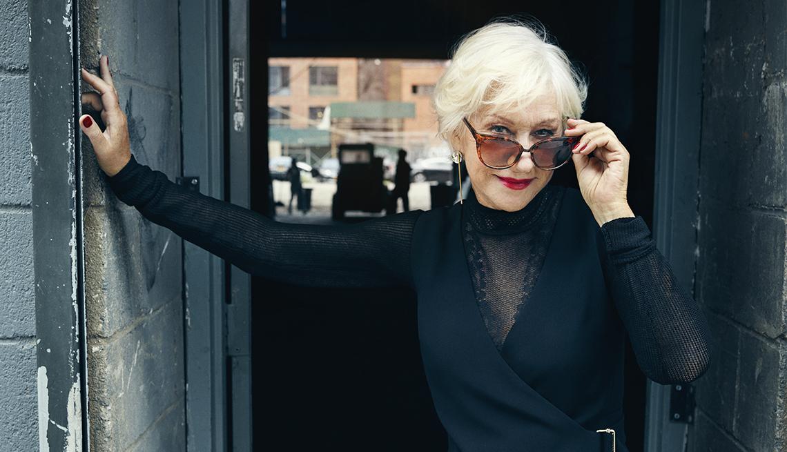 Helen Mirren looking over her sunglasses at camera