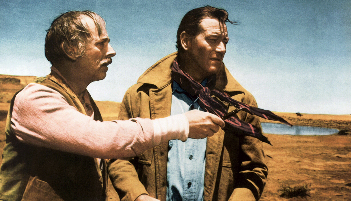 Actors John Qualen and John Wayne in 'The Searchers' movie.