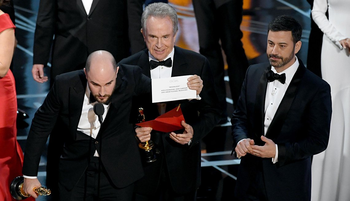 "item 12, Gallery image. ""La La Land"" producer Jordan Horowitz (left) holds up the card that reveals the actual best picture winner is ""Moonlight.""  Warren Beatty and host Jimmy Kimmel were also onstage."