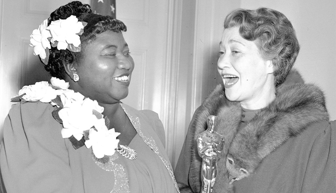 item 4, Gallery image. Hattie McDaniel (left) poses with an Oscar with Fay Bainter, the previous year's best supporting actress winner.