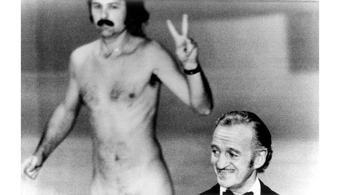 item 7, Gallery image. David Niven (right) cohosts the 1974 Oscars.