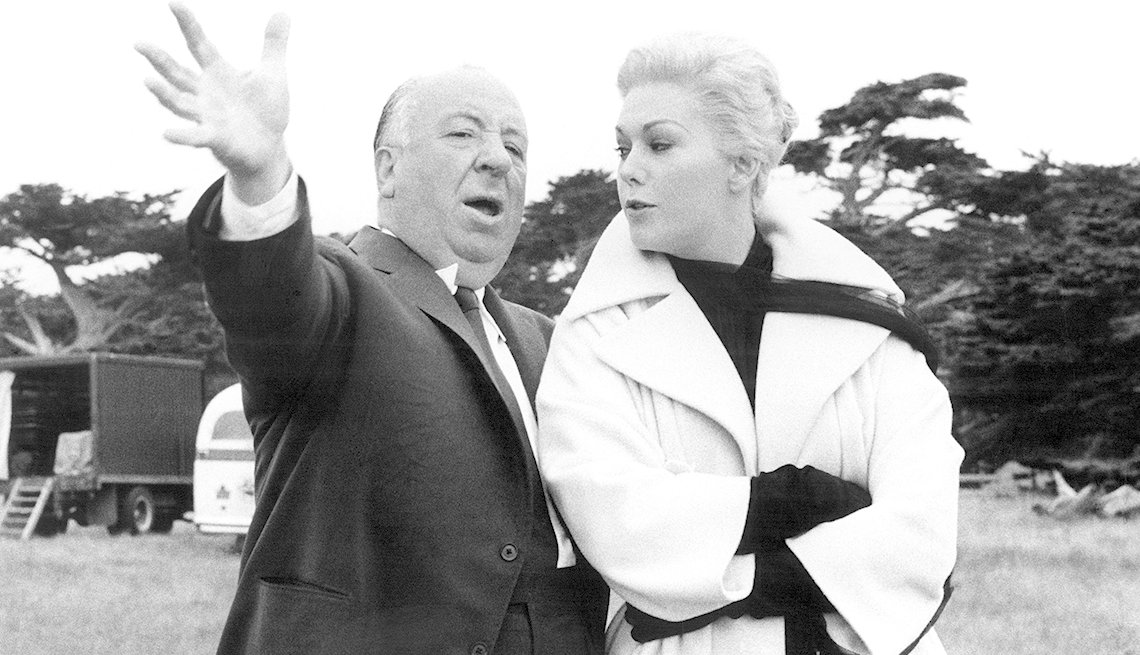 Director Albert Hitchcock directs actress Kim Novak on set of the film 'Vertigo'