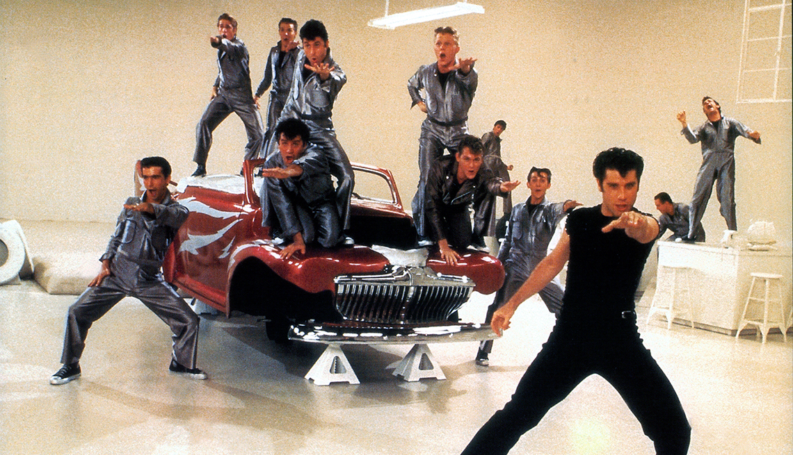 Michael Tucci, Barry Pearl, Jeff Conaway, John Travolta and others dance in a scene from the film 'Grease', 1978.