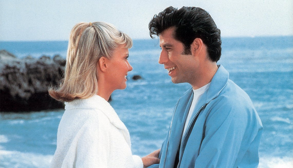 Olivia Newton-John and John Travolta on the beach in a scene from the film 'Grease'