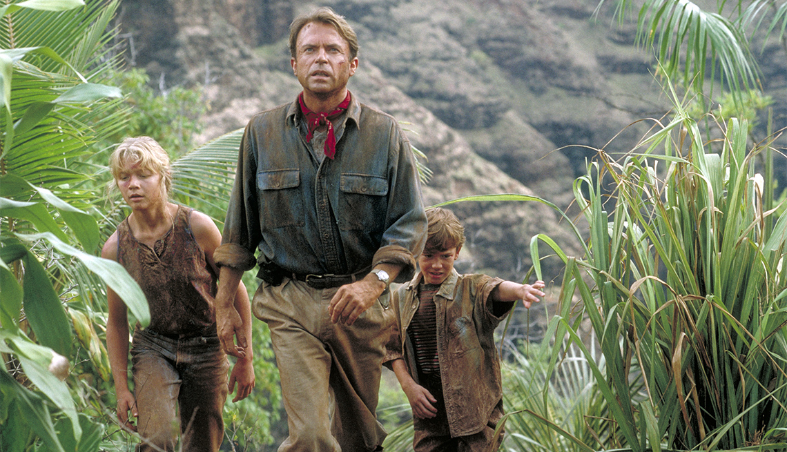 Actor Sam Neill as Dr. Alan Grant, with Ariana Richards (left) and Joseph Mazzello (right) as Lex and Tim, in a scene from the film 'Jurassic Park', 199