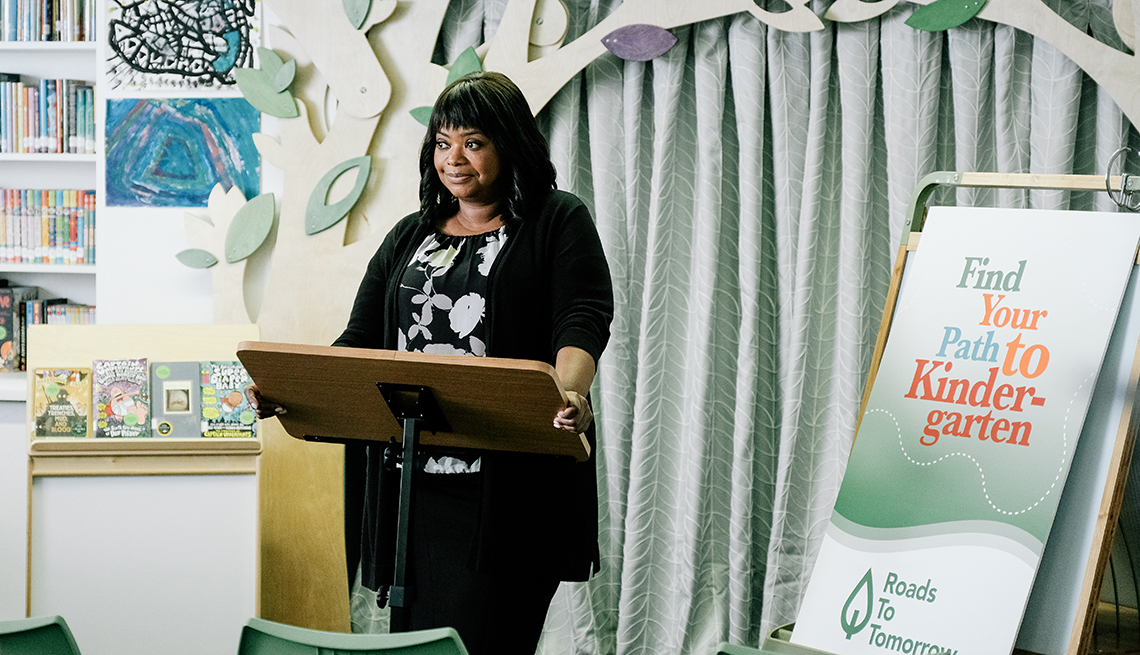 Octavia Spencer standing at a podium with books behind her.
