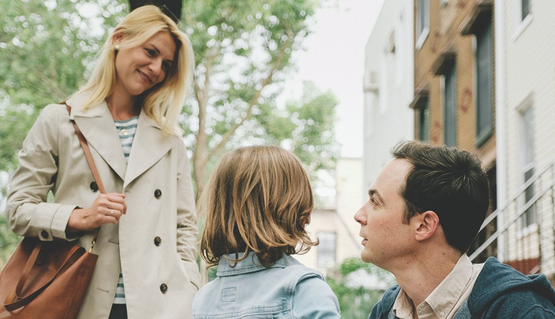Claire Danes holding a purse, looking at Leo James Davis and Greg Wheeler.