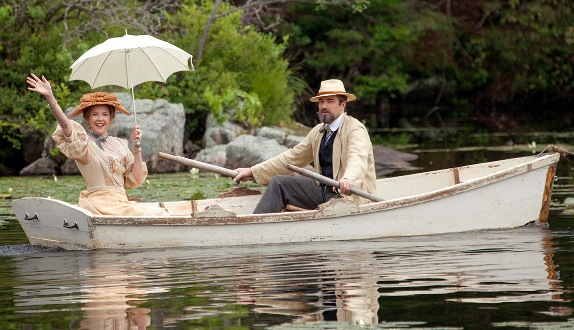"""rowing in a boat, Annette Bening and Jon Tenney in the movie """"The Seagull."""""""