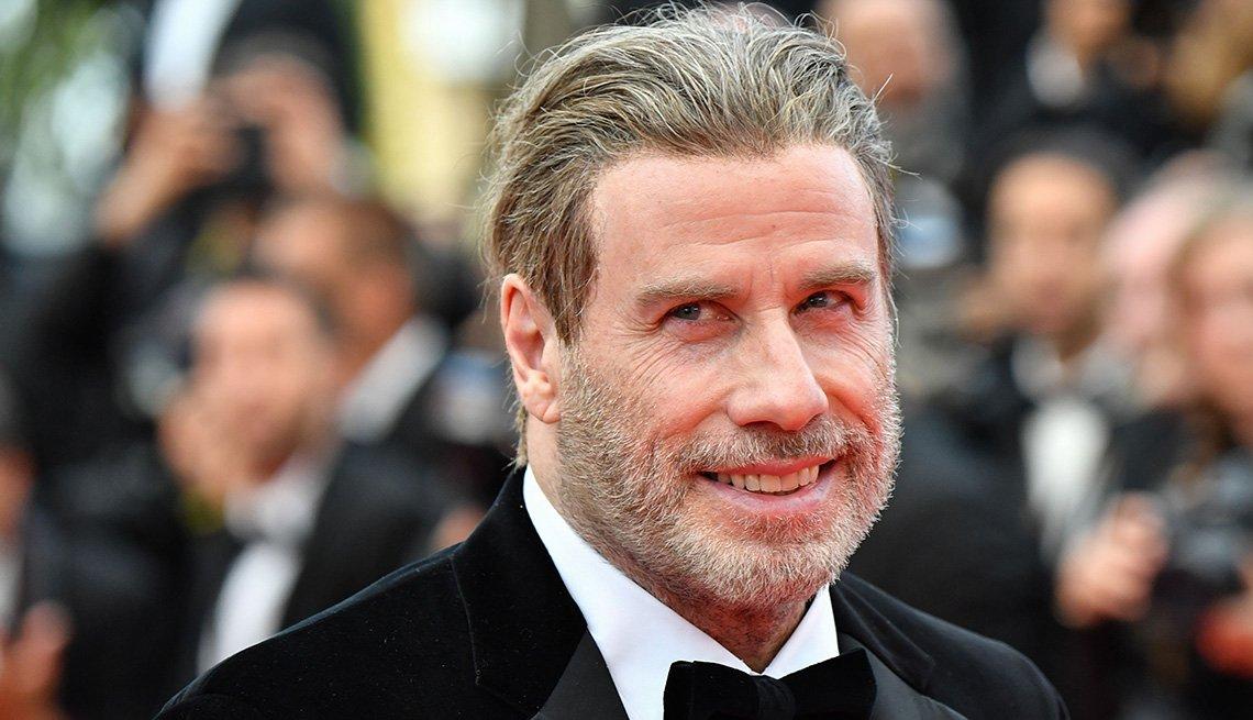 John Travolta wearing a tux.