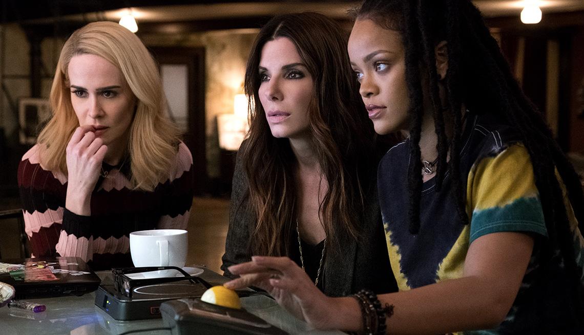 Sarah Paulson, Sandra Bullock, and Rihanna look at a screen in 'Ocean's 8'