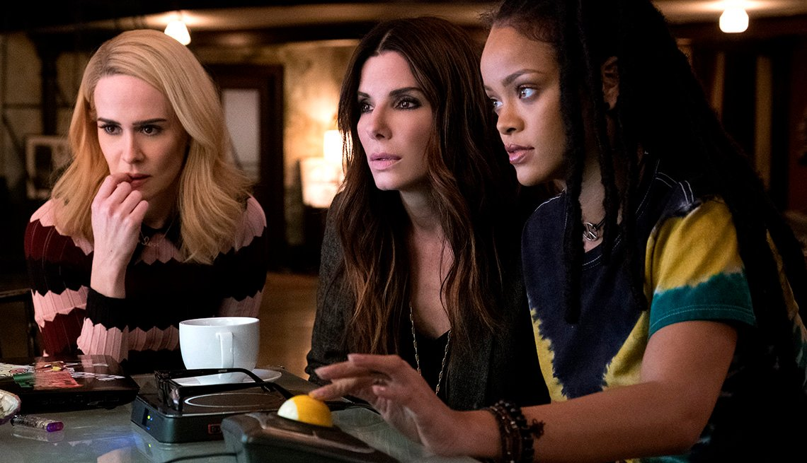 Sarah Paulson, Sandra Bullock, and Rihanna look at a screen in 'Ocean's 8'