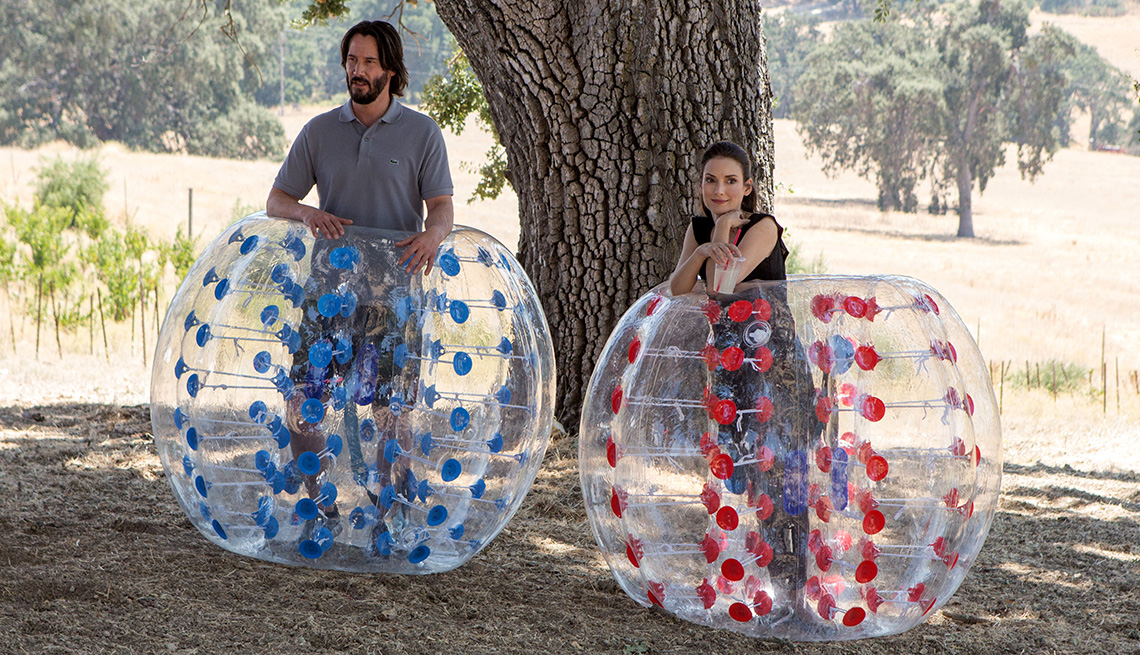 Keanu Reeves and Winona Ryder in blowup balls