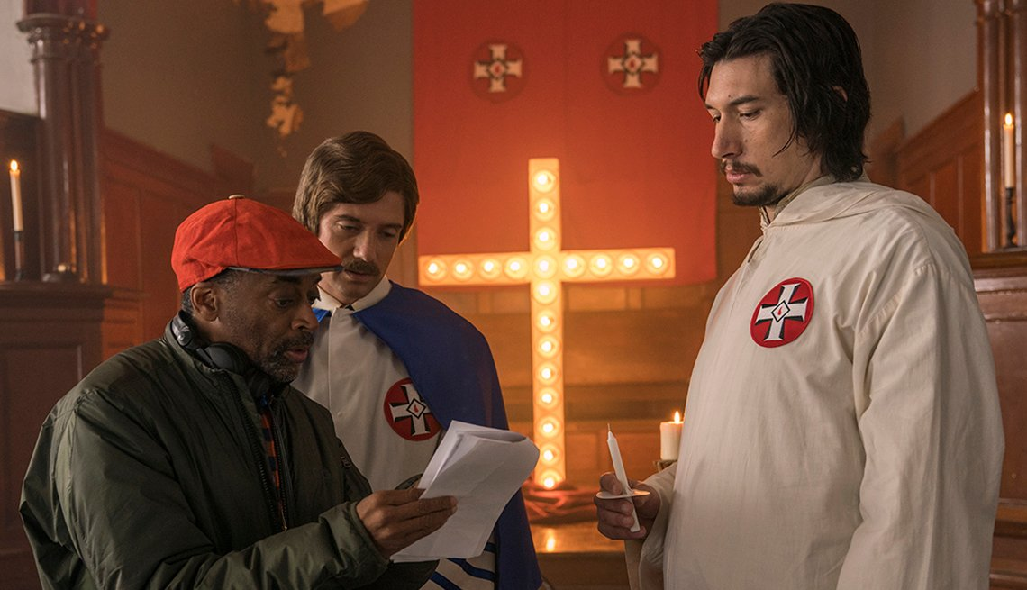 "Spike Lee directing Topher Grace and Adam Driver on the set of ""BlacKkKlansman."""