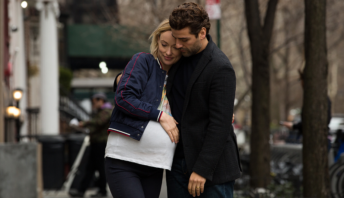 item 1 of Gallery image - Olivia Wilde and Oscar Isaac with their arms around each other.