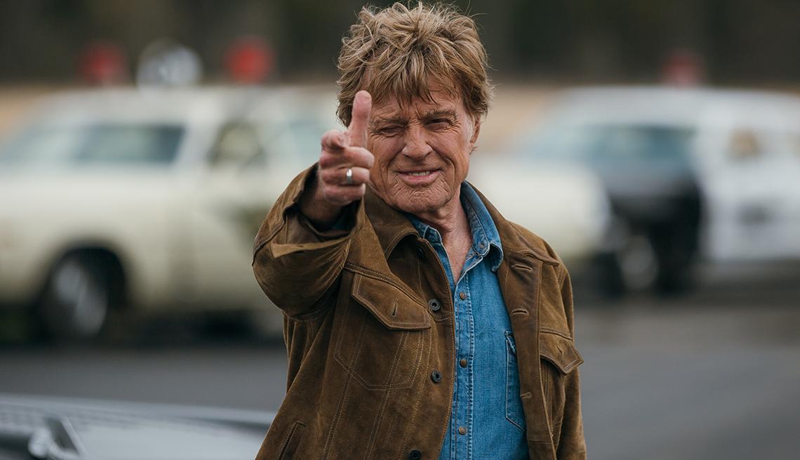Robert Redford pointing his finger like a gun.
