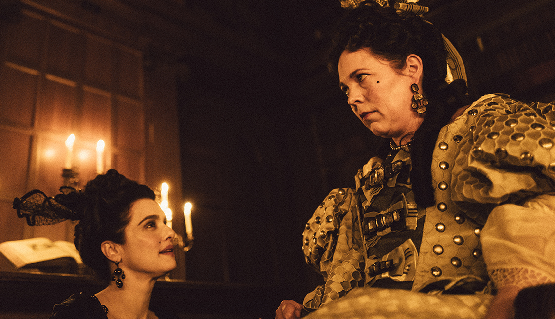 item 9 of Gallery image - Rachel Weisz and Olivia Colman looking at each other.