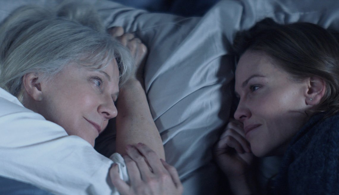 Blythe Danner and Hilary Swank laying next to each other.