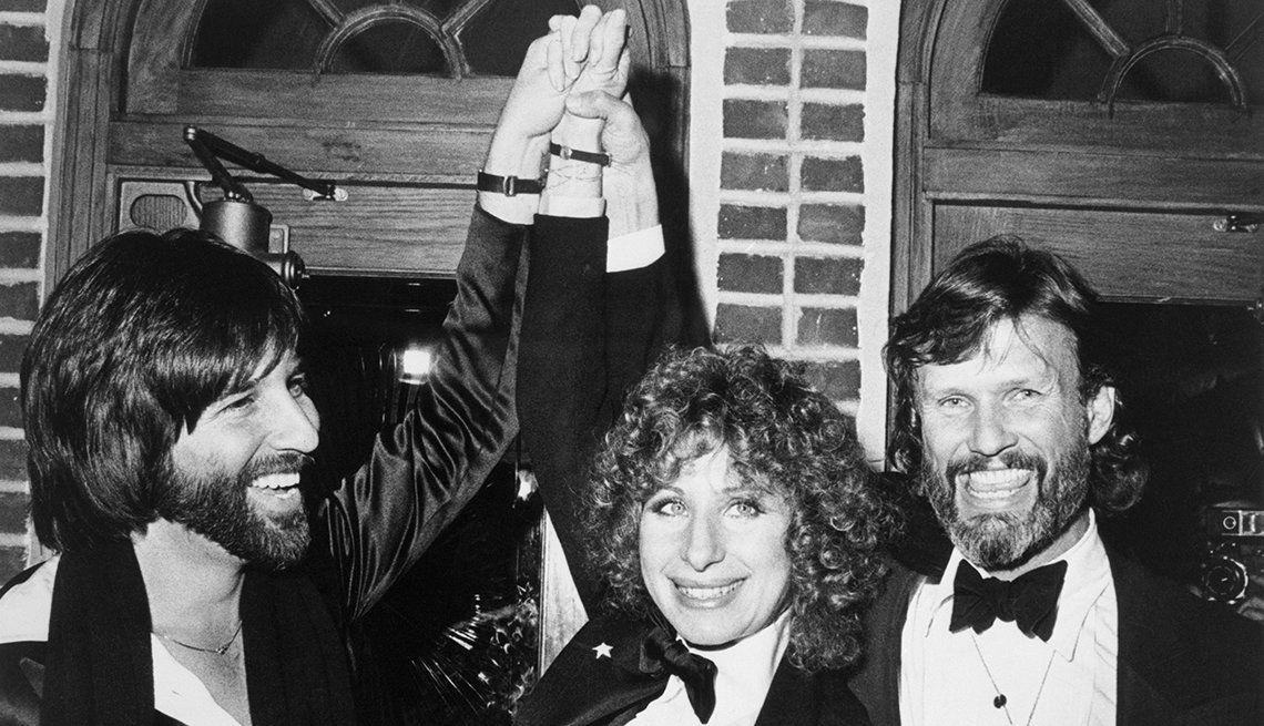 Barbra Streisand and Kris Kristofferson (R), stars of A Star Is Born, and Lon Peters the film's producer