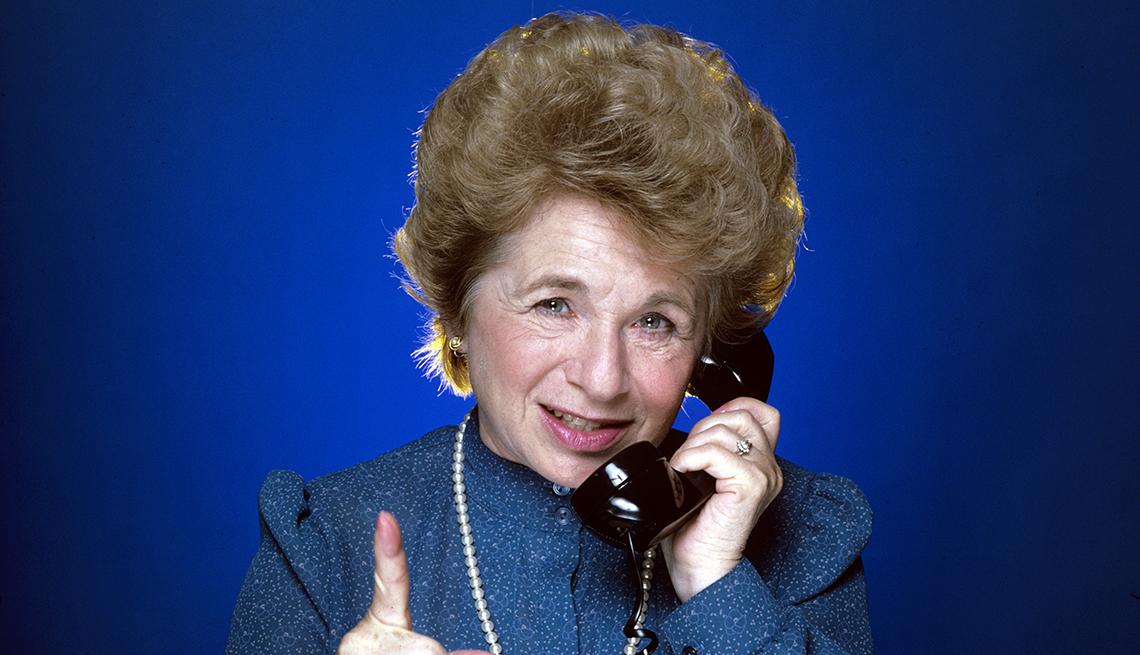 Doctor Ruth talks on a phone