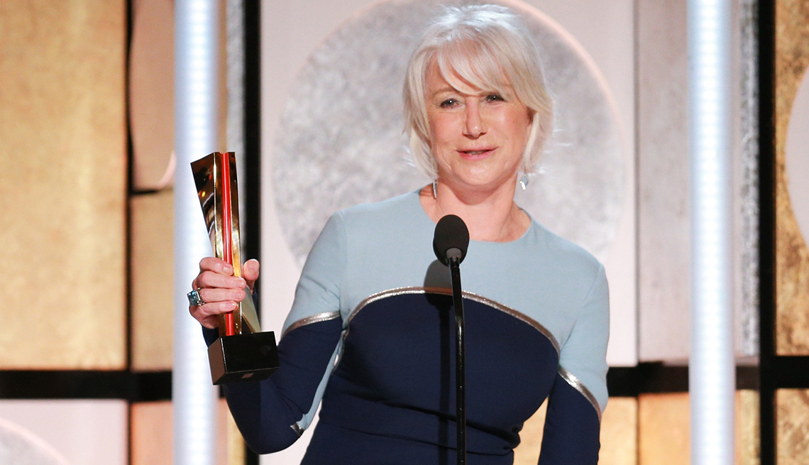 item 3 of Gallery image - Helen Mirren holding her Movies for Grownups Award