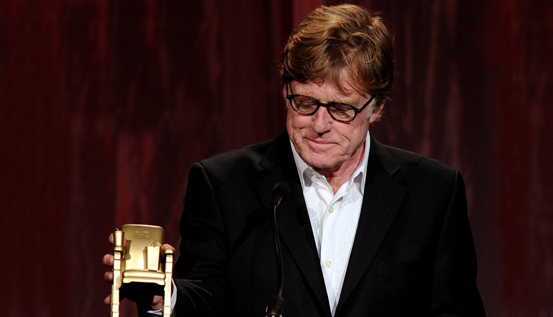 item 9 of Gallery image - Robert Redford looks down at his Movies for Grownups Award