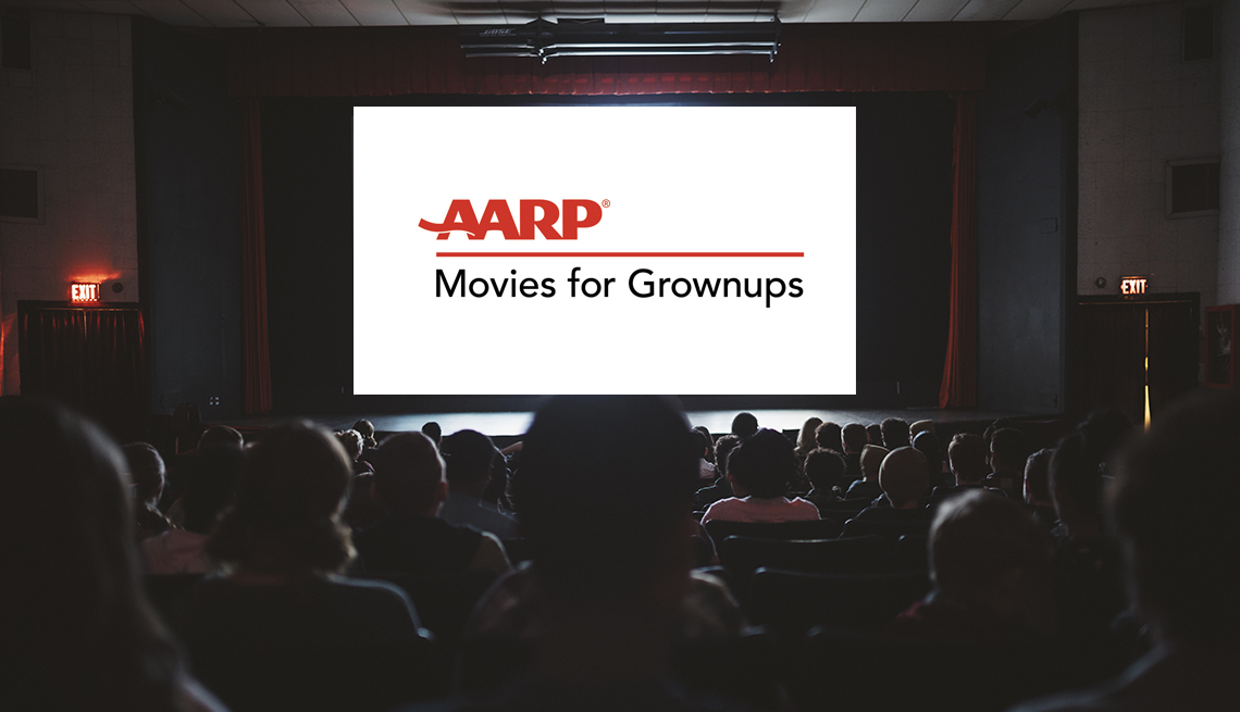 People watching a movie screen that reads AARP Movies for Grownups