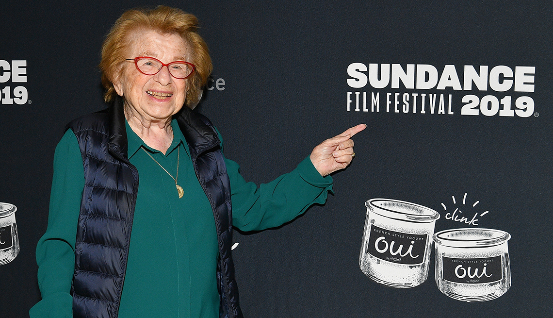 Dr. Ruth points to a Sundance Film Festival 2019 sign