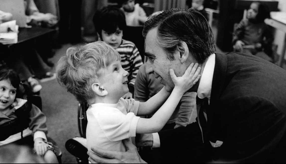 item 12 of Gallery image - Fred Rogers meets with a disabled boy in the film WON'T YOU BE MY NEIGHBOR?, a Focus Features release.