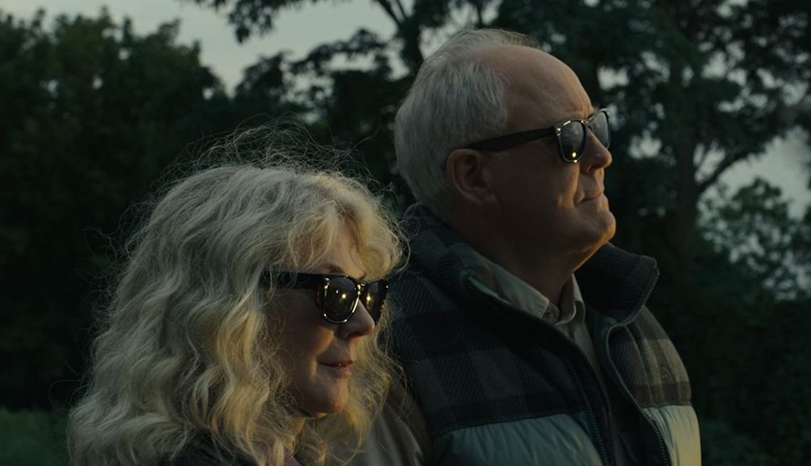 Blythe Danner and John Lithgow with shades on in a scene from 'The Tomorrow Man'