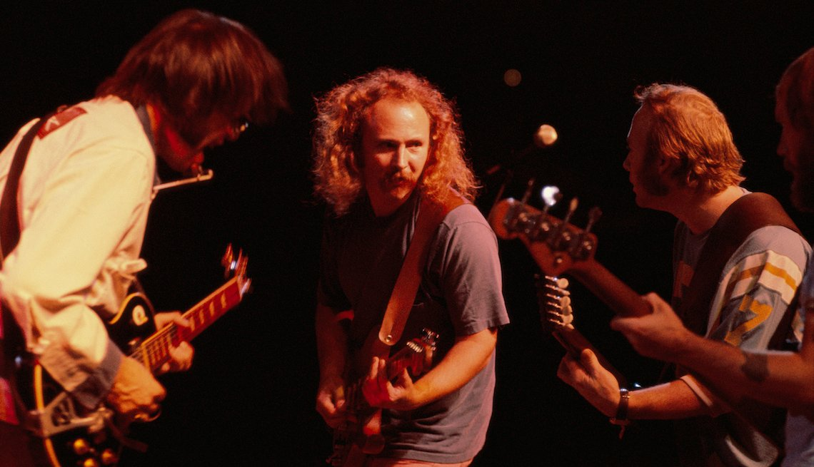 David Crosby (center), jamming with Neil Young (l), Stephen Stills (r) and Tim Drummond (bass), during a Crosby, Stills, Nash & Young concert at Texas Stadium, Dallas-Ft. Worth, Texas, August 31, 1974