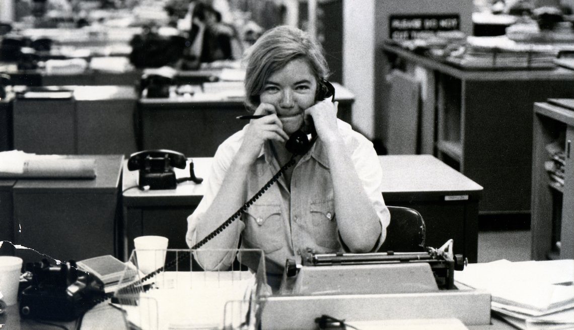 Molly Ivins sitting at a desk