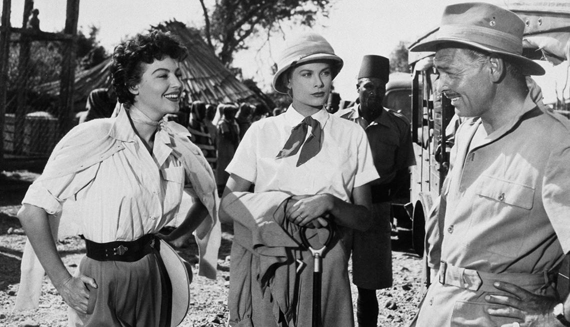 item 4 of Gallery image - Ava Gardner, Grace Kelly y Clark Gable en el set de la película Mogambo.
