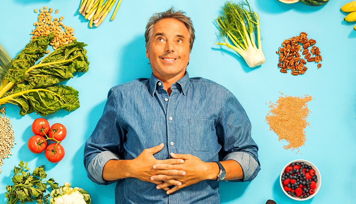 Dan Buettner surrounded by healthy food