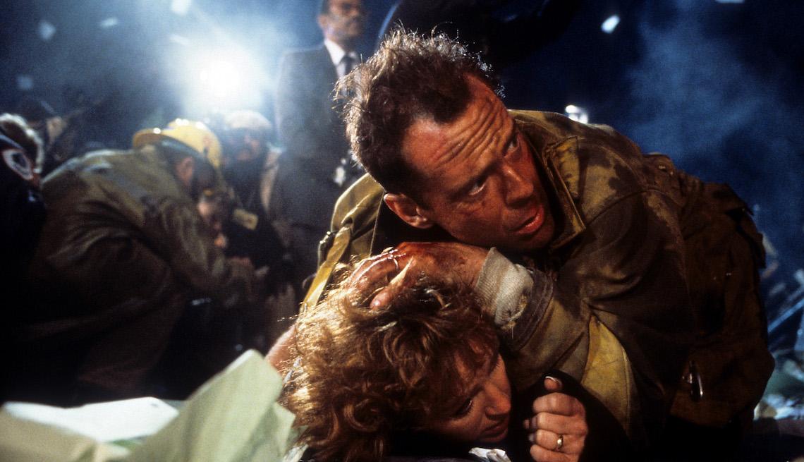 item 9 of Gallery image - Bonnie Bedelia is held down by Bruce Willis in a scene from the film 'Die Hard', 1988.