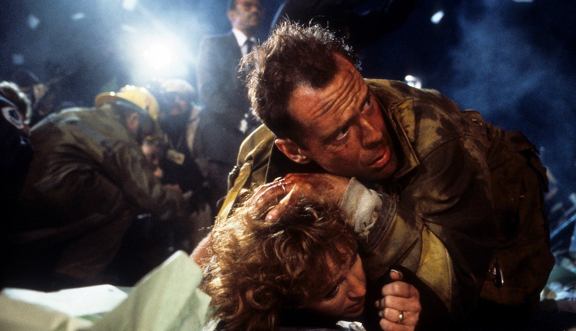 item 9 of Gallery image - Bonnie Bedelia is held down by Bruce Willis in a scene from the film 'Die Hard', 1988.