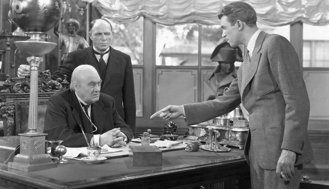 item 3 of Gallery image - James Stewart, as George Bailey, points at Lionel Barrymore in a scene from It's a Wonderful Life.