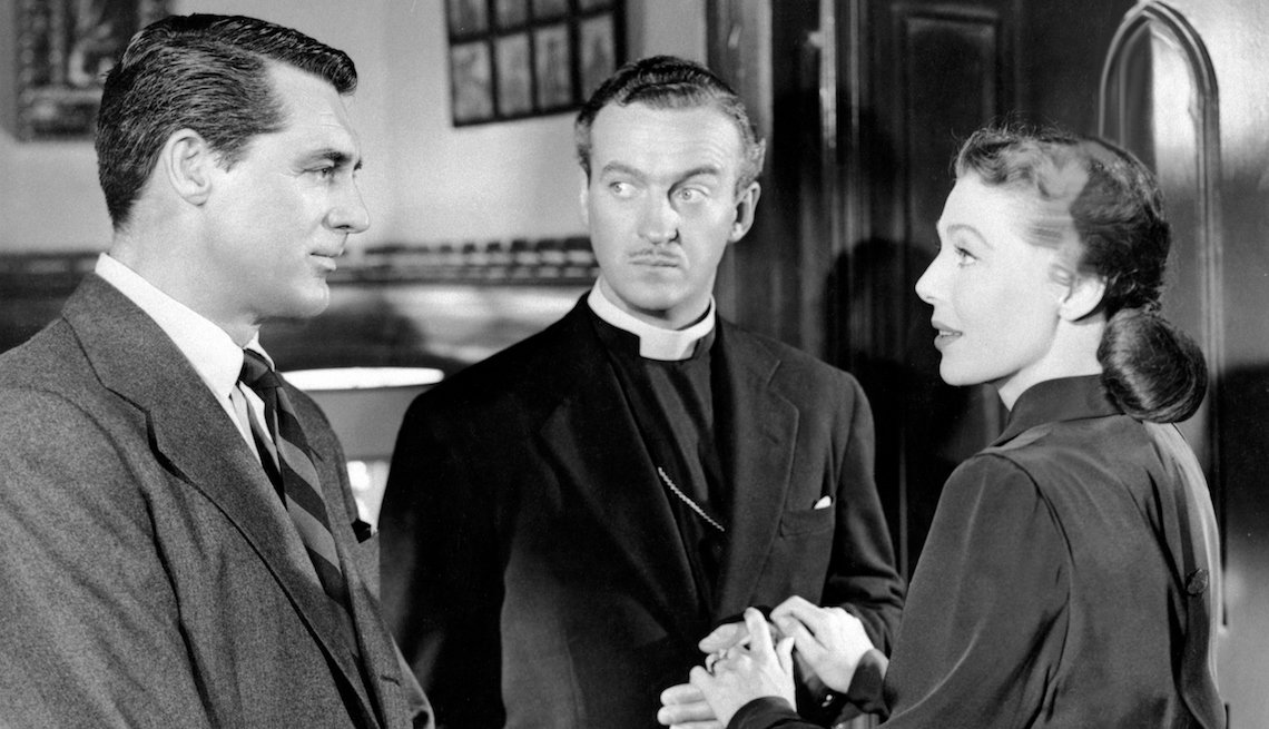 item 1 of Gallery image - American actors Cary Grant, Loretta Young British actor David Niven (C) on the set of The Bishop's Wife, based on the novel by Robert Nathan, and directed by Henry Koster.