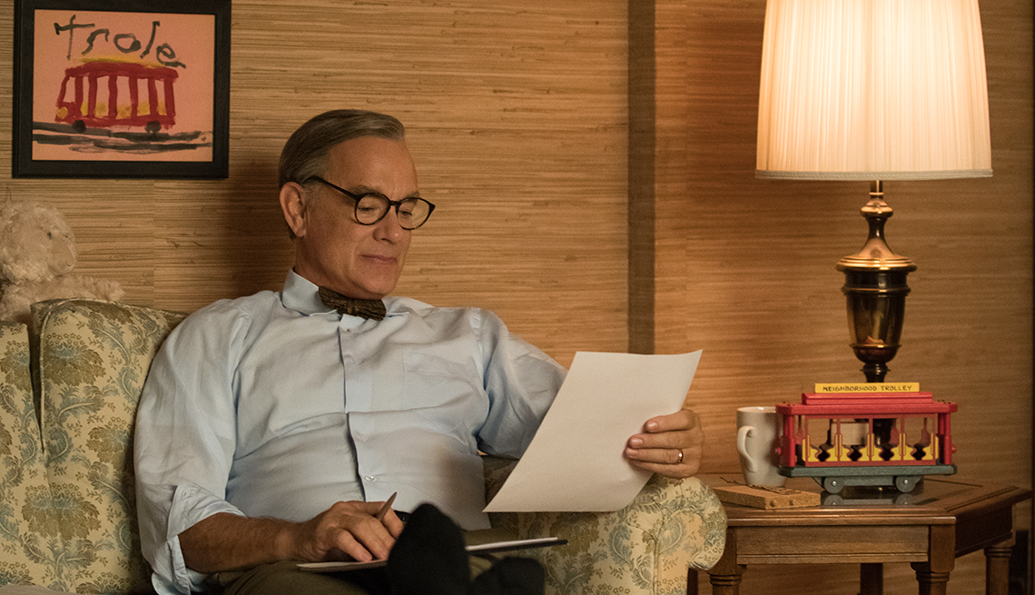 item 14 of Gallery image - Tom Hanks as Mister Rogers reading a sheet of paper in the film A Beautiful Day in the Neighborhood