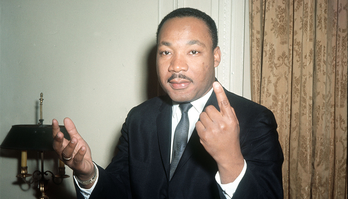 Dr. Martin Luther King, the American Black leader gestures as he carries on an animated conversation during a one-day visit to London