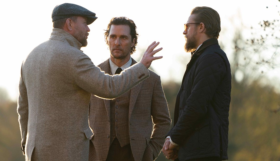 Director Guy Ritchie and actors Matthew McConaughey and Charlie Hunnam on set of the film The Gentleman