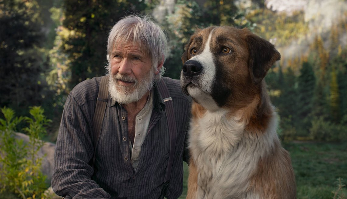 harrison ford alongside a dog in a still from the film call of the wild