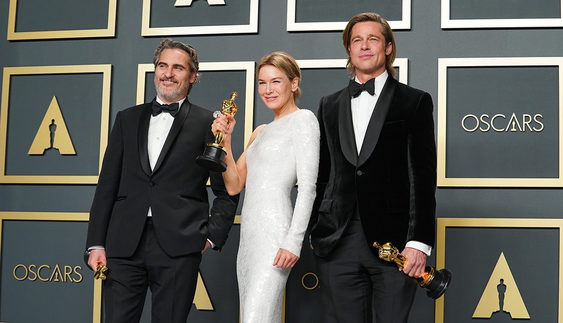 Joaquin Phoenix winner of the actor in a leading role award for Joker Renee Zellweger winner of the Actress in a Leading Role award for Judy and Brad Pitt winner of the Actor in a Supporting Role award for Once Upon a Time in Hollywood