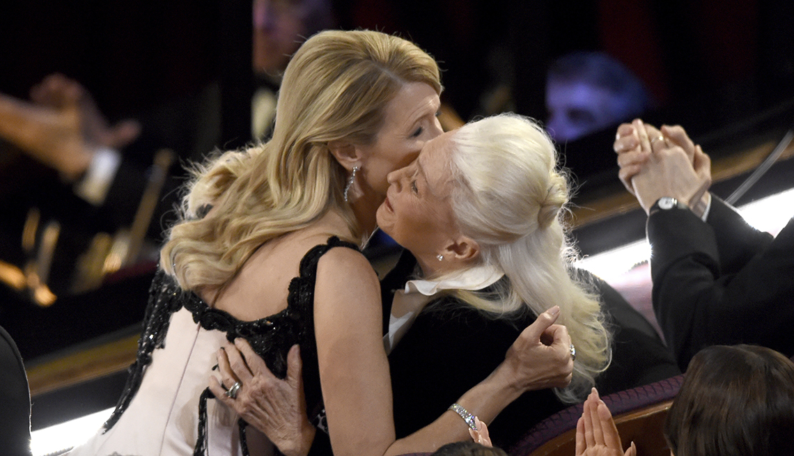Laura Dern is congratulated by Diane Ladd before going on stage to accept the award for best performance by an actress in a supporting role for Marriage Story at the Oscars on Sunday, Feb. 9, 2020, at the Dolby Theatre in Los Angeles.