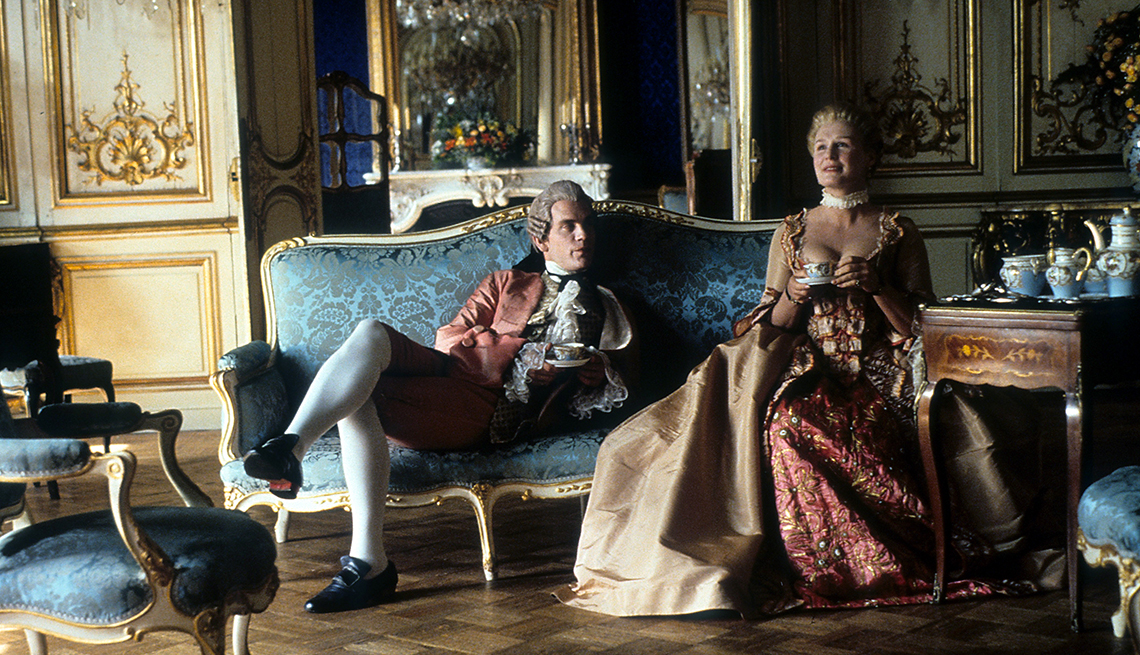 John Malkovich and Glenn Close having tea together in a scene from the film Dangerous Liaisons
